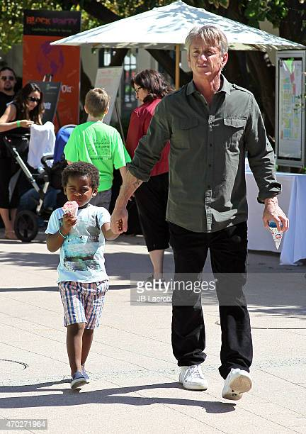 Jackson Theron and Sean Penn attend the generationOn West Coast Block Party on April 18 2015 in Beverly Hills California