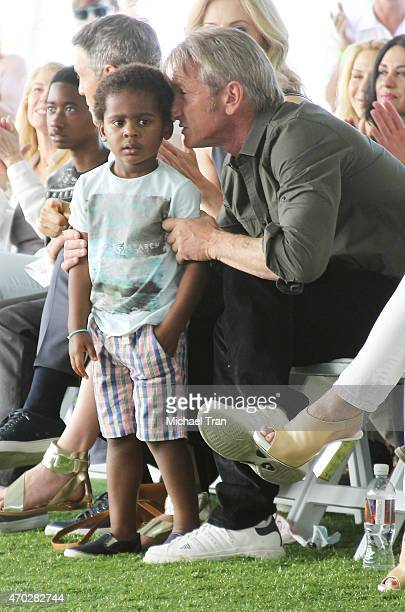 Jackson Theron and Sean Penn attend the generationOn West Coast Block Party held at Fox Studio Lot on April 18 2015 in Century City California