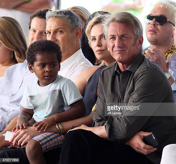 Jackson Theron Charlize Theron and Sean Penn attend the generationOn West Coast Block Party on April 18 2015 in Beverly Hills California