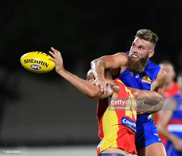 Jackson Trengove of the Bulldogs and Jarrod Witts of the Suns contest the ball during the 2019 JLT Community Series AFL match between the Gold Coast...