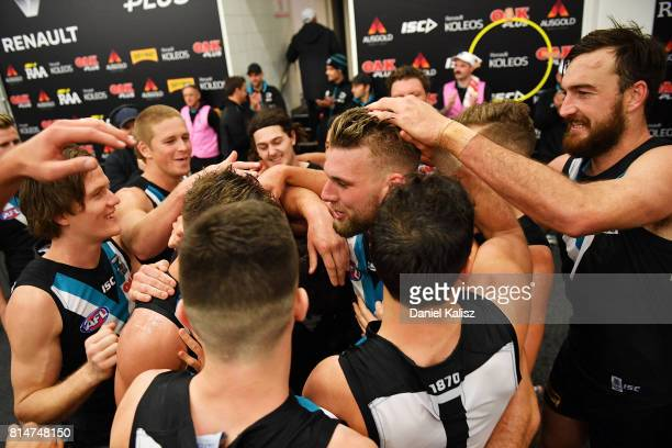Jackson Trengove of the Power celebrates with his team mates after the round 17 AFL match between the Port Adelaide Power and the North Melbourne...