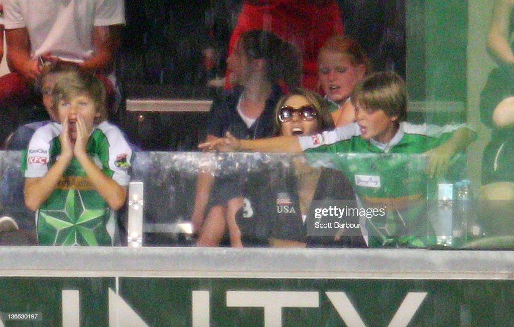 Jackson Warne, Elizabeth Hurley and her son Damian Hurley watch during the T20 Big Bash League match between the Melbourne Stars and the Melbourne Renegades at the Melbourne Cricket Ground on January 7, 2012 in Melbourne, Australia.