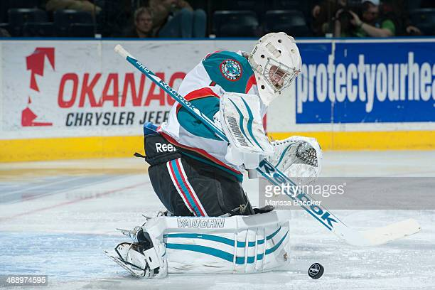 Jackson Whistle of the Kelowna Rockets deflects a shot against the Seattle Thunderbirds on February 10 2014 at Prospera Place in Kelowna British...