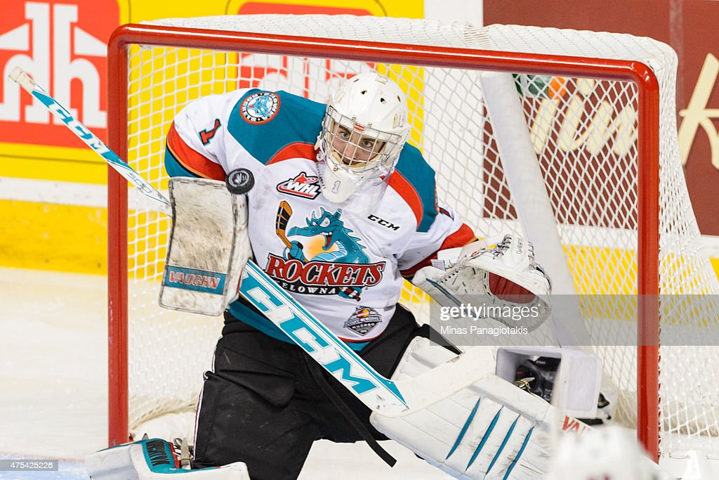 Jackson Whistle #1 of the Kelowna Rockets makes a blocker save during the 2015 Memorial Cup Championship against the Oshawa Generals at the Pepsi Coliseum on May 31, 2015 in Quebec City, Quebec, Canada.