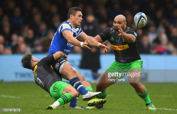 Jackson Willison of Bath Rugby is tackled by Danny Care of Harlequins and Paul Lasike of Harlequins during the Gallagher Premiership Rugby match...