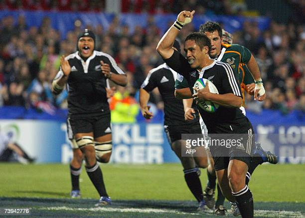 Jackson Willison of New Zealand scores New Zealands fourth try aganist South Africa 21 April 2007 during the IRB Under 19 World Championship final at...