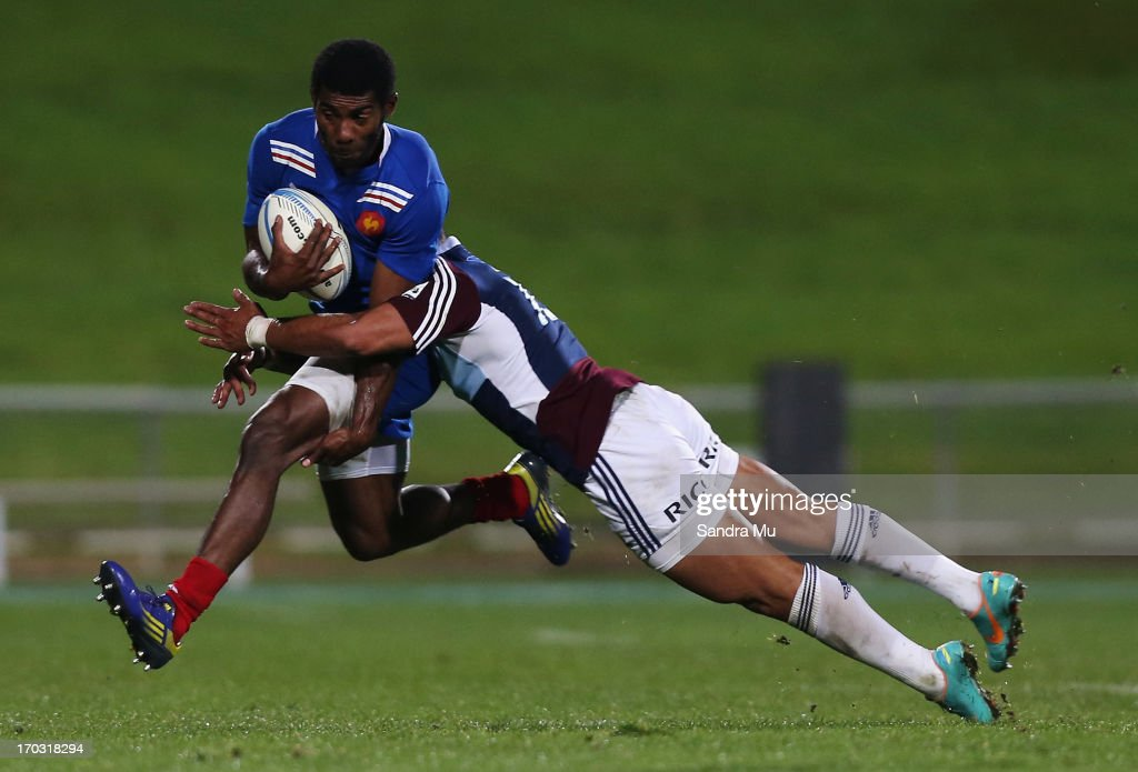 Jackson Willison of the Blues tackles Noa Nakaitaci of France during the tour match between the Auckland Blues and France at North Harbour Stadium on June 11, 2013 in Auckland, New Zealand.