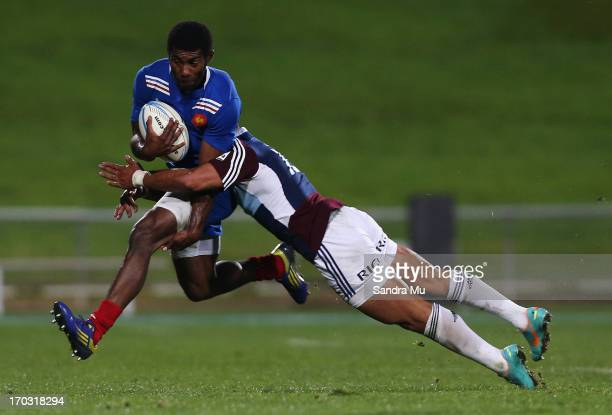 Jackson Willison of the Blues tackles Noa Nakaitaci of France during the tour match between the Auckland Blues and France at North Harbour Stadium on...