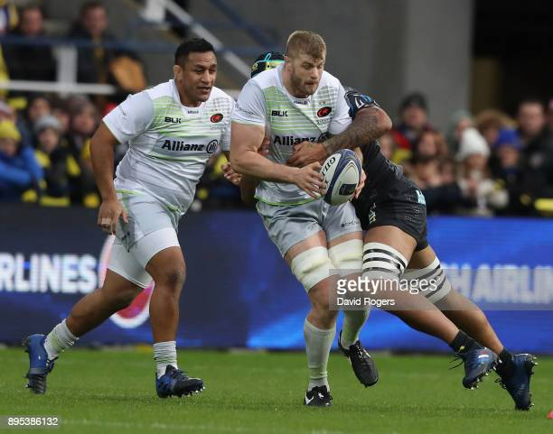 Jackson Wray of Saracens charges upfield with Mako Vunipola in support during the European Rugby Champions Cup match between ASM Clermont Auvergne...