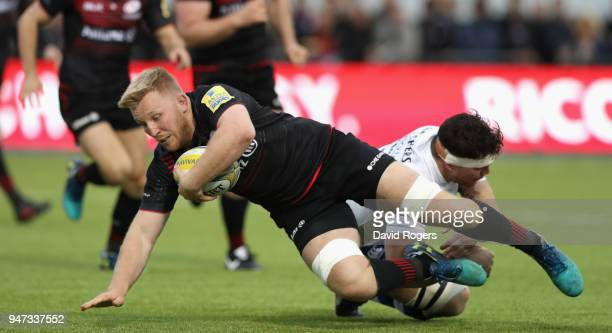 Jackson Wray of Saracens is tackled during the Aviva Premiership match between Saracens and Bath Rugby at Allianz Park on April 15 2018 in Barnet...