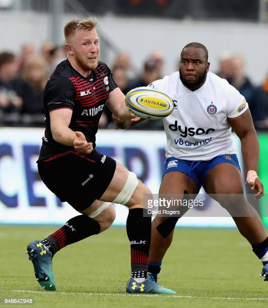 Jackson Wray of Saracens passes the ball as Beno Obano looks on during the Aviva Premiership match between Saracens and Bath Rugby at Allianz Park on...