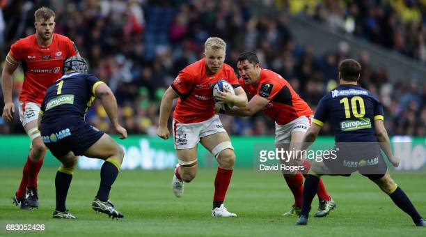 Jackson Wray of Saracens takes on Raphael Chaume and Camille Lopez during the European Rugby Champions Cup Final between ASM Clermont Auvergen and...