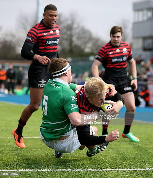 Jackson Wray scroes a try for Saracens during the LV= Cup match between Saracens and Newcastle Falcons at Allianz Park on January 26 2014 in Barnet...