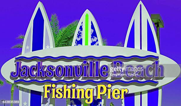 jacksonville beach fishing pier on surfboards - jacksonville beach stock pictures, royalty-free photos & images