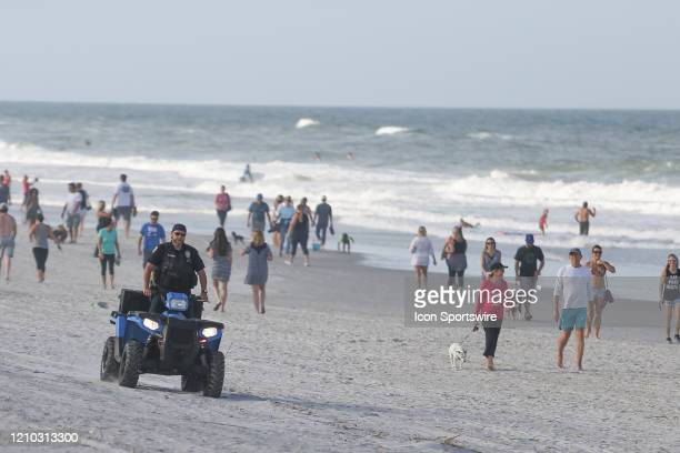 Jacksonville Beach police officer patrols the crowded beaches in its first open hour on April 17, 2020 in Jacksonville Beach, Fl. Jacksonville Mayor...