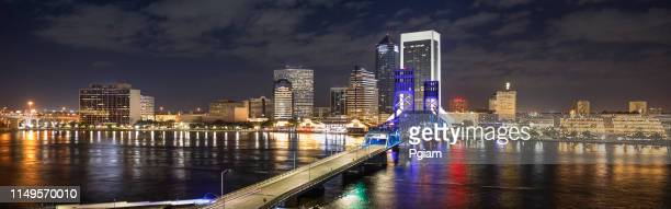 jacksonville florida panorama city skyline at night - jacksonville florida stock pictures, royalty-free photos & images