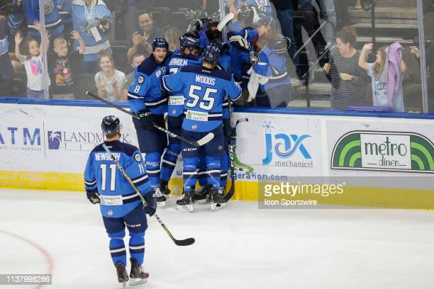 Jacksonville Icemen players celebrate a goal during the game between the Florida Everblades and the Jacksonville Icemen on April 18 2018 at the...