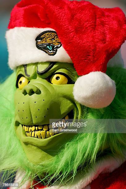 Jacksonville Jaguar fan wears a grinch mask in a game against the Oakland Raiders at Jacksonville Municipal Stadium on December 23 2007 in...