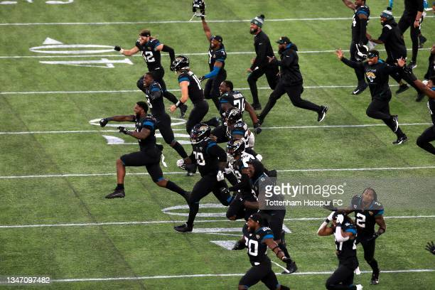 Jacksonville Jaguars celebrate after Matthew Wright kicks a last minute field goal to win during the NFL London 2021 match between Miami Dolphins and...