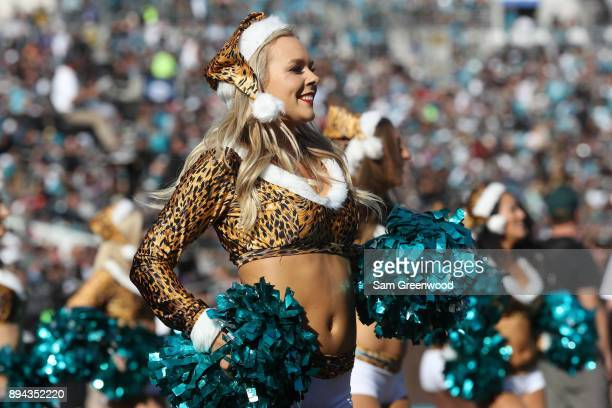 Jacksonville Jaguars cheerleaders perform on the field during the start of their game against the Houston Texans at EverBank Field on December 17...