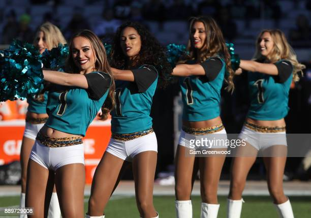 Jacksonville Jaguars cheerleaders perform on the field prior to the start of their game against the Seattle Seahawks at EverBank Field on December 10...