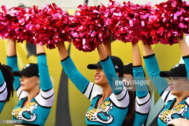 Jacksonville Jaguars cheerleaders raise thier pink poms during the fourth quarter of a football game against the New York Jets at TIAA Bank Field on...