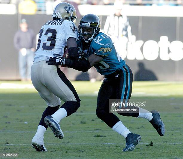 Jacksonville Jaguars cornerback Fernando Bryant misses a tackle on New Orleans Saints wide receiver Donte Stallworth with seconds on the clock...