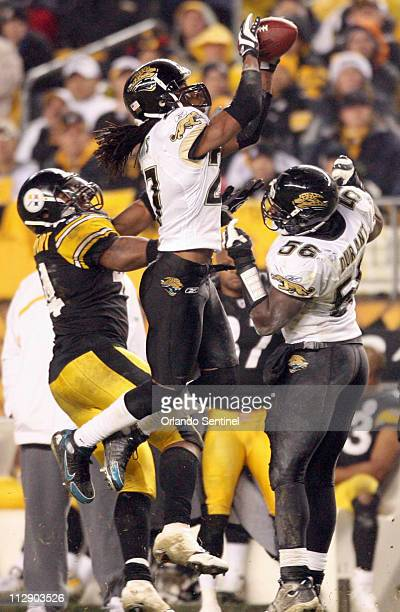 Jacksonville Jaguars cornerback Rashean Mathis makes an interception over Pittsburgh Steelers running back Najeh Davenport in the first half of an...
