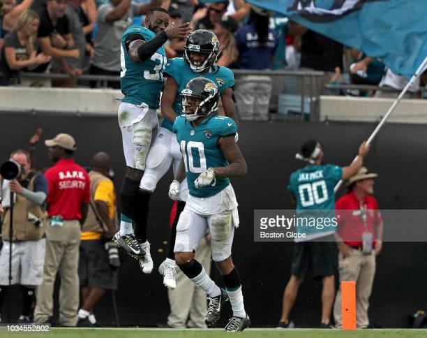 Jacksonville Jaguars defensive back Tashaun Gipson and Jacksonville Jaguars wide receiver Dede Westbrook celebrate after Westbrook's long run for a...