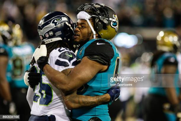 Jacksonville Jaguars defensive end Dante Fowler Jr and Seattle Seahawks cornerback Shaquill Griffin greet each other following the game between the...
