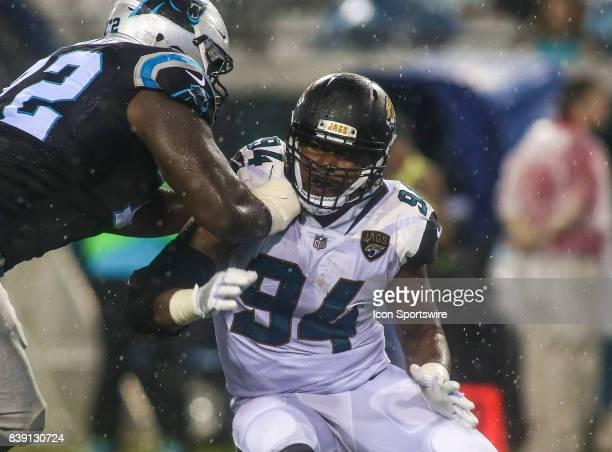 Jacksonville Jaguars defensive end Dawuane Smoot battles Carolina Panthers offensive lineman Taylor Moton during the game against the Carolina...