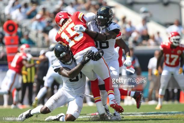Jacksonville Jaguars Defensive End Yannick Ngakoue and Jacksonville Jaguars Safety Ronnie Harrison hit Kansas City Chiefs Quarterback Patrick Mahomes...