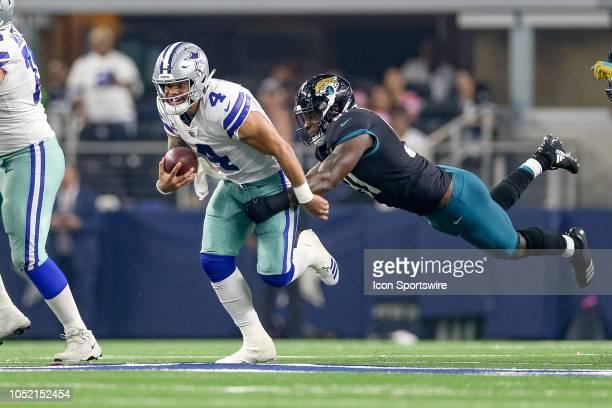 Jacksonville Jaguars defensive end Yannick Ngakoue dives to tackle Dallas Cowboys quarterback Dak Prescott during the game between the Jacksonville...