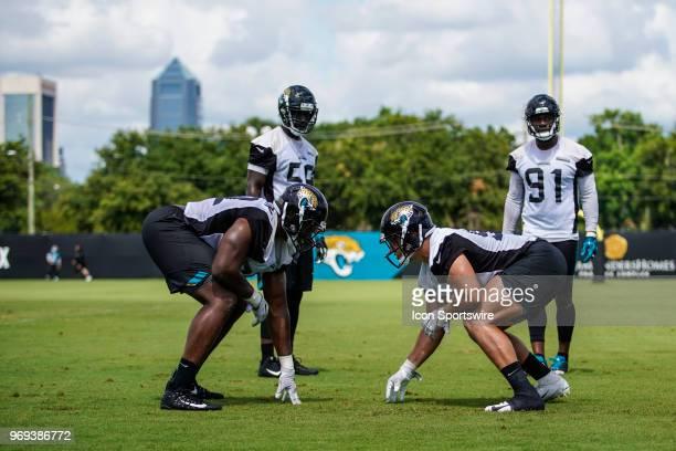 Jacksonville Jaguars defensive lineman Taven Bryan and Jacksonville Jaguars defensive lineman Lyndon Johnson line up for a drill during the Jaguars...