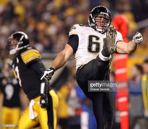 Jacksonville Jaguars defensive tackle Derek Landri celebrates tackling Pittsburgh Steelers quarterback Ben Roethlisberger left during the first half...