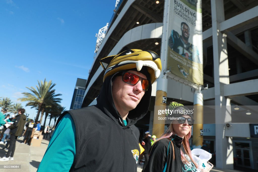 Jacksonville Jaguars fans walk past the stadium before the start of their AFC Wild Card playoff game against the Buffalo Bills at EverBank Field on January 7, 2018 in Jacksonville, Florida.