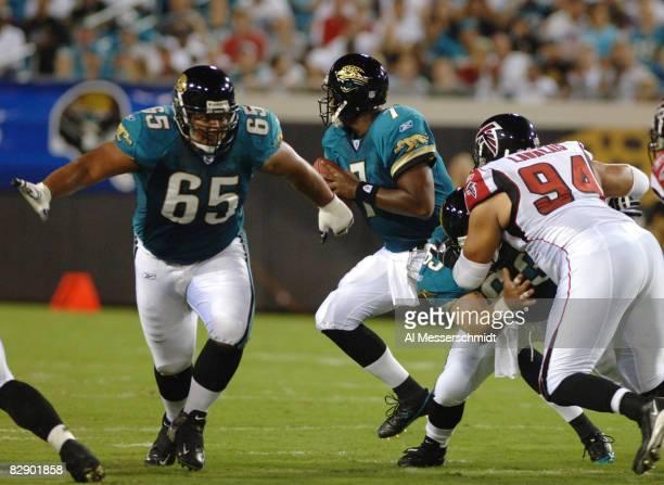 Jacksonville Jaguars guard Chris Naeole sets to block in the rain against the Atlanta Falcons in a preseason game August 25 2005 in Jacksonville