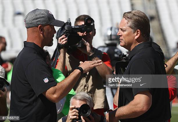 Jacksonville Jaguars head coach Gus Bradley left greets Oakland Raiders head coach Jack Del Rio prior to their game at EverBank Field on October 23...