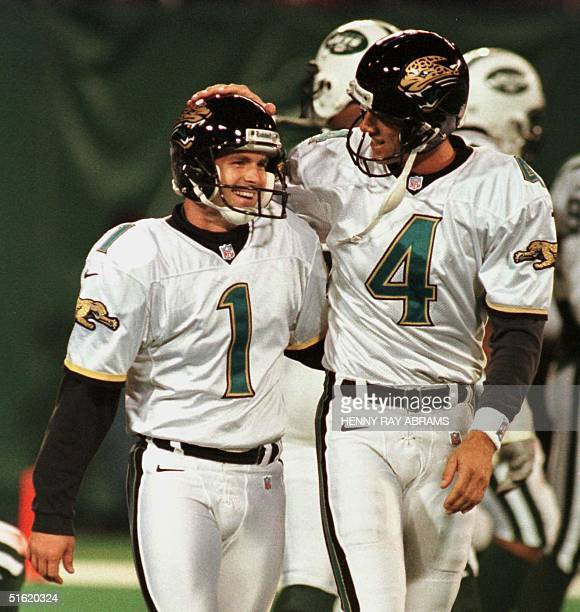 Jacksonville Jaguars' kicker Mike Hollis is congratulated by teammate Bryan Barker after Hollis made the third of his his three field goals against...