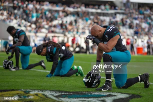 Jacksonville Jaguars Linebacker Austin Calitro kneels in prayer prior to the game between the Indianapolis Colts and the Jacksonville Jaguars on...