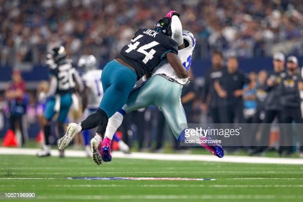 Jacksonville Jaguars linebacker Myles Jack tackles Dallas Cowboys running back Ezekiel Elliott during the game between the Jacksonville Jaguars and...