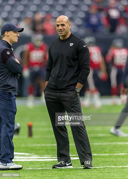 Jacksonville Jaguars linebackers coach Robert Saleh chats with a member of the Houston Texans staff during the NFL game between the Jacksonville...