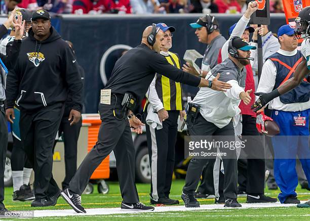 Jacksonville Jaguars linebackers coach Robert Saleh congratulates a player during the NFL game between the Jacksonville Jaguars and Houston Texans on...