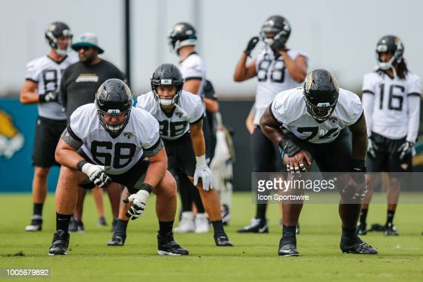 Jacksonville Jaguars offensive lineman Andrew Norwell and Jacksonville Jaguars offensive lineman Cam Robinson line up for a play during the...