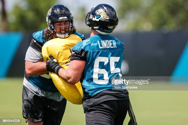 Jacksonville Jaguars offensive lineman Andrew Norwell and Jacksonville Jaguars offensive lineman Brandon Linder work through a drill during the...