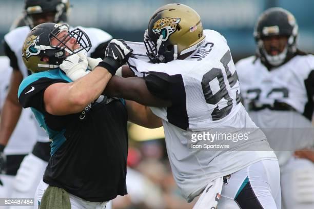 Jacksonville Jaguars offensive lineman Brandon Linder and Jacksonville Jaguars defensive tackle Arby Jones battle through a drill during the Jaguars...