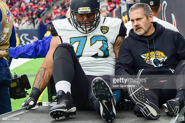 Jacksonville Jaguars Offensive Tackle Jeremiah Poutasi is carted from the field with a leg injury during the NFL game between the Jacksonville...