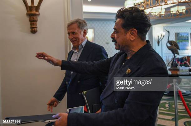Jacksonville Jaguars owner Shahid Kahn and Los Angeles Rams owner Stan Kroenke talk after a meeting at the 2018 NFL Annual Meetings at the Ritz...