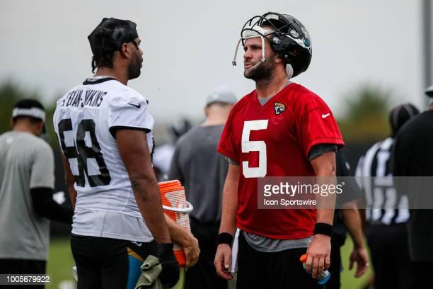 Jacksonville Jaguars quarterback Blake Bortles and Jacksonville Jaguars tight end Austin SaferianJenkins chat during the Jacksonville Jaguars...