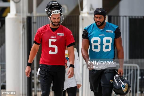 Jacksonville Jaguars quarterback Blake Bortles and Jacksonville Jaguars tight end Austin SaferianJenkins walk out to the practice field during the...